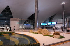 Modern Dubai airport. Modern style interior with shining metal constructions and lots of light. Royalty Free Stock Photo