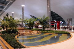 Modern Dubai airport. Modern style interior with shining metal constructions and lots of light. Stock Image