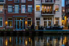 Modern Dutch buildings at the canal, City architecture by night, Alphen aan den Rijn, the Netherlands royalty free stock photos