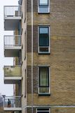 Modern dutch city architecture, apartments complex with balconies and windows stock photos