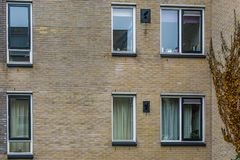 Modern dutch city architecture, Windows in a brick wall, architectural background stock photos