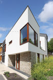 Modern Dutch home with white facade Stock Photography