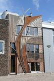 Modern Dutch home with wooden curved facade. And rusty metal plates in Leiden, built in 2011 Royalty Free Stock Image