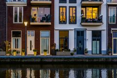 Modern dutch houses at the canal, city architecture by night, Alphen aan den Rijn, The Netherlands stock images