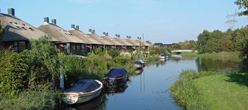 Modern Dutch houses in Holland on the waterside royalty free stock photography