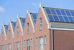 Modern Dutch houses with solar panels on roof. Sunny and blue sky. Heerhugowaard, Netherlands Royalty Free Stock Photo