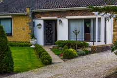 Modern dutch luxurious home with a front garden, New architecture in the Netherlands royalty free stock image