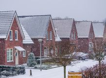 Modern dutch neighborhood during a cold winter day, snowy weather in the streets of a dutch village stock photos