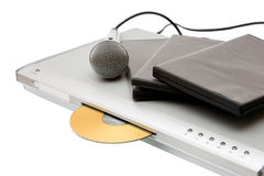 Modern dvd player with microphone and disks. Modern dvd player with karaoke function and microphone stock photography
