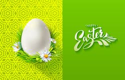 Modern Easter egg in grass with greetings Stock Photos