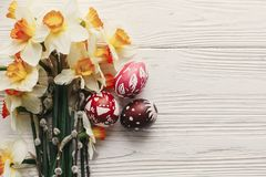 Modern easter flat lay. stylish colorful easter eggs with spring Stock Photo