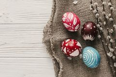 Modern easter flat lay. stylish colorful easter eggs on rustic w Royalty Free Stock Photo