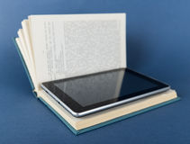 Modern ebook reader in traditional book Royalty Free Stock Photo