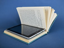 Modern ebook reader in traditional book Stock Photography