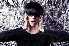 Modern eccentric woman portrait, glitter metallic background.  Stock Photo