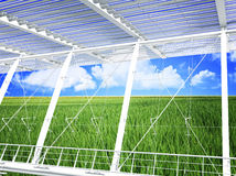 Modern eco building. Green grass field and blue cloudy sky modern eco building 3d Royalty Free Stock Image