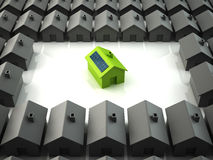 Modern eco house standing out from the crowd Royalty Free Stock Photo