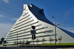 Modern edifice of the Latvian city Riga. The Castle of Light is a new building of the Latvian national library. The glassy edifice is photographed at sunset Royalty Free Stock Photos