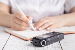 Modern Education concept, recording lecture on voice recorder instead of writing stock images