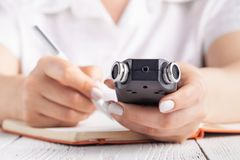Modern Education concept, recording lecture on voice recorder instead of writing stock photos