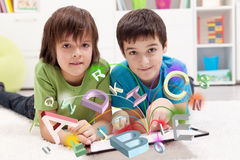 Modern education and online learning possibilities. Boys using tablet computer Stock Photography