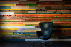 Modern egg chair on a colorful wooden wall Stock Image