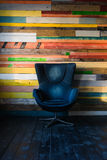 Modern egg chair on a colorful wooden wall Royalty Free Stock Photography