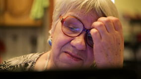 Modern elderly woman using skype
