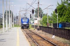 Modern electric blue cargo locomotive Royalty Free Stock Photography