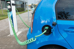 Modern electric car charging Royalty Free Stock Photo