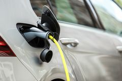 Free Modern Electric Car Charging With Power Cable Royalty Free Stock Photography - 122616447