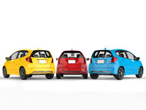 Modern electric cars in primary colors - back view Royalty Free Stock Photography
