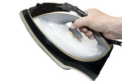 Modern electric iron in a hand Stock Photo