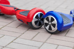 Modern electric mini segway hover board scooter Stock Photos