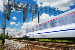 Modern electric passenger train moving on full speed Stock Photography