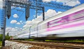 Modern electric passenger train moving on full speed Royalty Free Stock Image