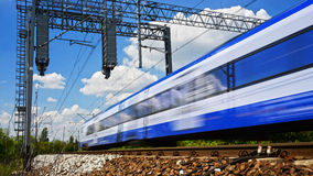 Modern electric passenger train moving on full speed Stock Photos