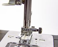Modern electric sewing machine on a white background royalty free stock photos