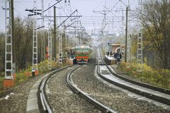 Modern electric train arrives on a station Royalty Free Stock Image