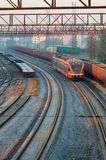 Modern electric train moving through railway station Royalty Free Stock Images