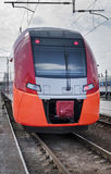Modern electric train stops at the station. 2015 Royalty Free Stock Photography