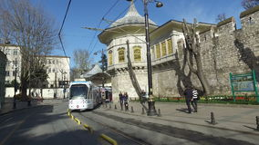 Modern electric tram passing by in Istanbul. ISTANBUL, TURKEY - FEBRUARY 15, 2016: Modern electric tram passing by in Istanbul stock video footage