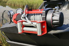 Modern electric winch increases the permeability of the vehicle in difficult road conditions Royalty Free Stock Photos