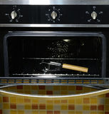 The modern electrical oven. With a grid Royalty Free Stock Photography