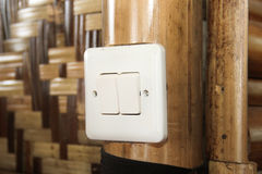 Modern electrical switch of country hut. Stock Photography