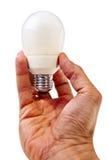 Modern electricity saving lightbulb hold by male h Stock Photo