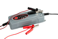 Modern electronic charger for car battery with terminals and jum Stock Photos