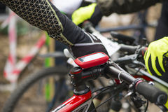 Modern electronic gps device attached to bicycle handlebar Royalty Free Stock Photo