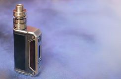 Modern electronic mod vaping device. New vaporizer e-cig gadget to vape e-liquid Stock Photo