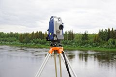 Modern electronic tachymeter mounted on tripod Royalty Free Stock Photography